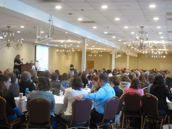 image of conference presenter and large room full of librarians